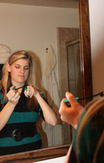 Teen Girl Looking at Mascara
