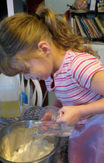 Cooking with one hand - girl with hemiplegia.