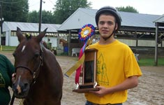 Boy with horse and trophy