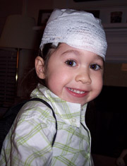 Child with her head bandaged