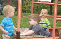 Boys Playing on Jungle Gym