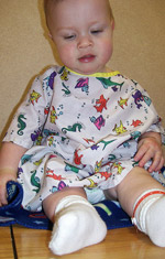 Baby in a hospital gown