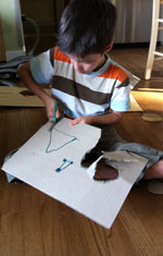 Boy Cutting Paper
