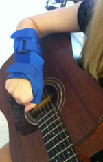 Arm with Brace Playing Guitar