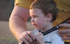 Child learning baseball