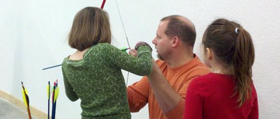 Girls Learning Archery