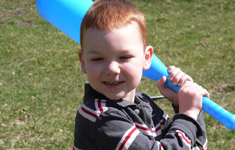Young child with a plastic bat
