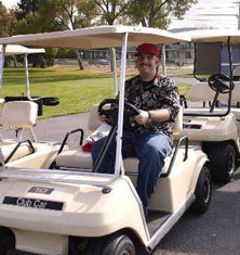 Man in Golf Cart