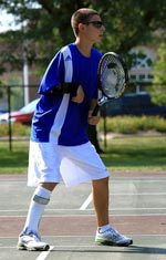 Boy waiting to play tennis