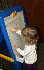 Girl Drawing on Easel