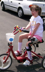 Girl in a brace riding her bike